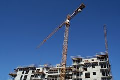 Cranes over building site. Building site of new settlement Royalty Free Stock Photos