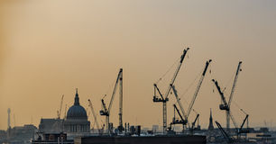 Cranes over London rooftops. Royalty Free Stock Photo