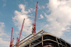 Cranes over modern building Stock Photos