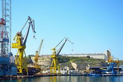 Cranes in Paola docks, Malta. Royalty Free Stock Images