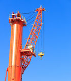 Cranes at port area and blue sky Stock Photos