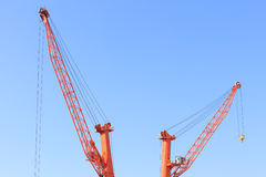 Cranes at port area and blue sky Stock Photography