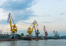 Cranes at a port in the evening Royalty Free Stock Photography