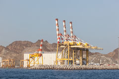 Cranes in the port of Muscat, Oman Stock Photos