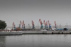 Cranes in port with poor colors. Cranes in cargo port with poor colors Royalty Free Stock Photo