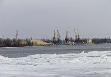 Cranes in the  port on a river Dnieper at winter Royalty Free Stock Photos