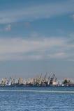 Cranes of Riga port. Cranes in Riga port at Baltic sea on Daugava river. Vertical shot Royalty Free Stock Photography