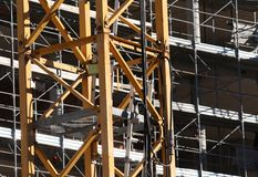 Cranes and scaffolding during construction of a building Royalty Free Stock Images