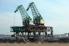 Cranes and scrapyard Stock Photos