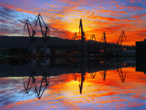 Cranes in Sestao at sunset Stock Photo