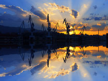 Cranes in Sestao with sunset sun rays Royalty Free Stock Photos