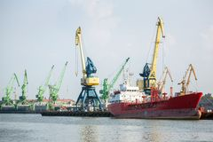 Cranes and ship in Klaipeda harbor Stock Photo
