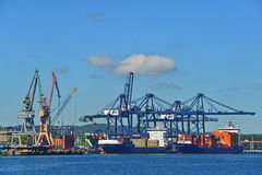 Cranes and ships in the harbor Stock Images