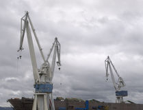 Cranes in a shipyard Stock Images
