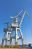 Cranes in the shipyard. Royalty Free Stock Images