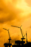 Cranes silhouettes building construction. Royalty Free Stock Photo