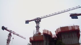 Cranes at Singapore construction site Stock Images