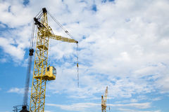 Cranes in the sky. Yellow cranes in the sky. Building and architecture Stock Image
