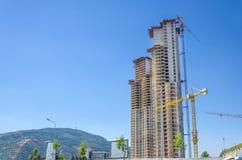 Cranes on the skyscraper construction site Stock Image