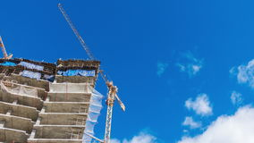 Cranes at a skyscraper construction. Tme lapse video.