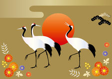 Cranes and sunrise on gold background with japanese floral patterns Stock Photography