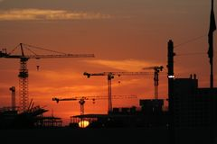 Cranes on sunset. A city skyline with tower cranes in the sunset Royalty Free Stock Photography