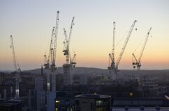 Free Cranes Surrounded By Buildings During The Sunset In The Evening In Edinburgh In Scotland Royalty Free Stock Photography - 178891837