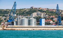 Cranes and tanks in Cargo terminal of Balchik port Stock Photography