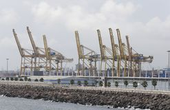 Cranes to load and unload cargo freighters in barcelona port. The term stevedore has come to mean a stevedoring firm that contracts with a port, shipowner, or stock photography