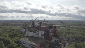 Cranes that took part in the liquidation of the accident at the Chernobyl nuclear power plant on which birds sit with a view  year