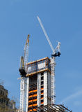 Cranes on top of new building Royalty Free Stock Photography