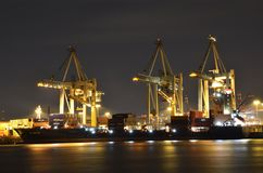 Cranes unloaded big cargo ship in port Stock Photography