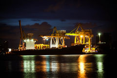 Cranes unloading a ship in a harbor Stock Photography