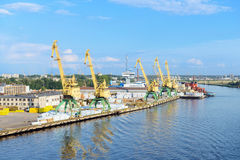 Cranes and vessels in cargo terminal Stock Photos