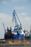 Cranes wharf repairing ship Royalty Free Stock Photo