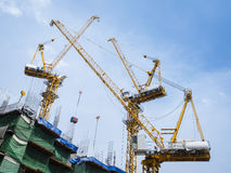 Cranes work in construction site Stock Photo
