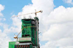 Cranes working on the building tower Royalty Free Stock Image