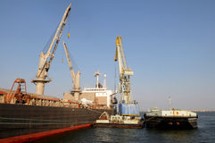 Cranes Working at a Cargo Ship Royalty Free Stock Image