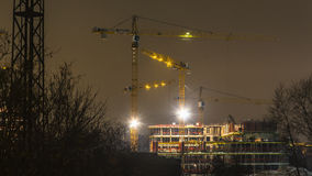 Cranes working on construction of the housing estate in former Stock Photo