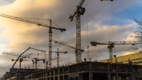 Cranes working on construction of the housing estate in former i stock video