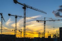 Cranes working on construction of the housing estate in former i Royalty Free Stock Image