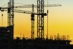 Cranes working on construction of the housing estate in former i Royalty Free Stock Photo