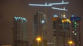 Cranes working on construction of the housing estate in former i stock video footage