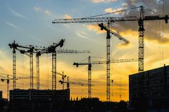 Cranes working on construction of the housing estate in former i Stock Photography