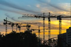 Cranes working on construction of the housing estate in former i Stock Image