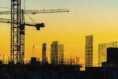 Cranes working on construction of the housing estate in former i Royalty Free Stock Photography