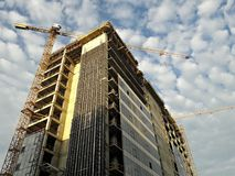 Cranes working at a new building Royalty Free Stock Photos