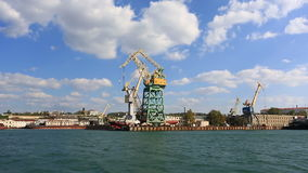 Cranes working in the port of Sevastopo. L, a view from the floating ship stock video footage