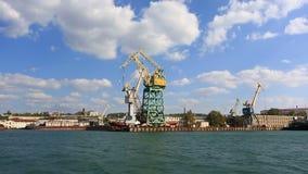 Cranes working in the port of Sevastopo stock video footage