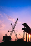 Cranes working at sunset. Silhouette of several cranes working at sunset in a harbor Stock Photography